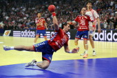 Serbia's Alem Toskic jumps to score during the men's EHF Euro 2012 Handball Championship semifinal match Serbia vs Croatia on January 27 2012 at the...