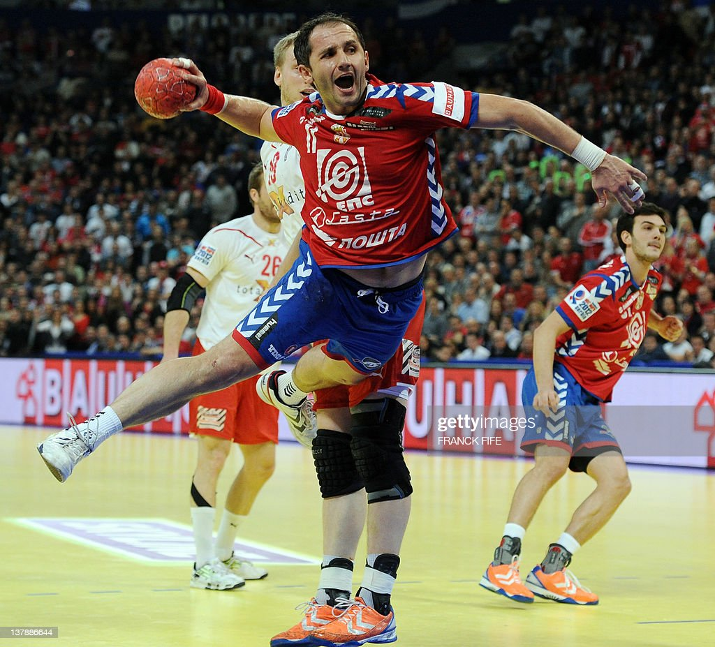 Serbia's Alem Toskic jumps to score during the men's EHF Euro 2012 Handball Championship final Serbia vs Denmark on January 29, 2012 at the Beogradska Arena in Belgrade.