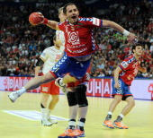 Serbia's Alem Toskic jumps to score during the men's EHF Euro 2012 Handball Championship final Serbia vs Denmark on January 29 2012 at the Beogradska...