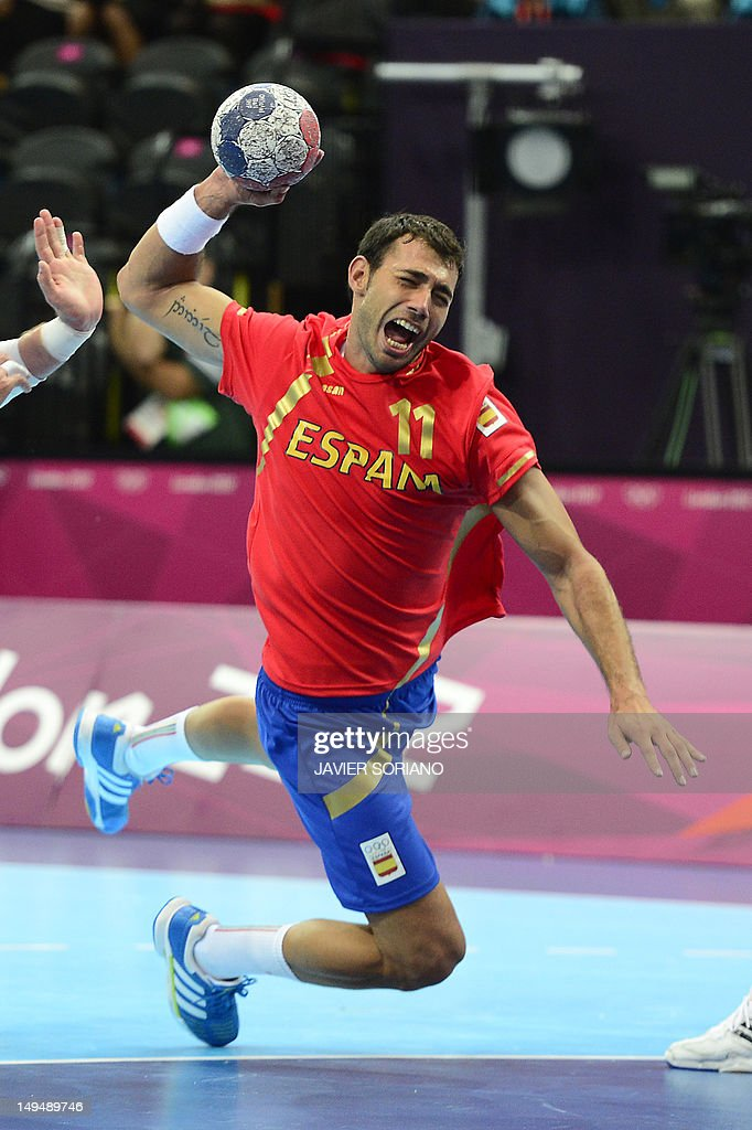 Serbia's Alem Toskic jumps to shoot during the men's preliminaries Group B handball match Spain vs Serbia for the London 2012 Olympics Games on July 29, 2012 at the Copper Box hall in London.