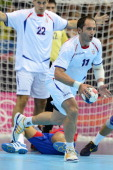 Serbia's Alem Toskic runs with the ball during the men's preliminaries Group B handball match Spain vs Serbia for the London 2012 Olympics Games on...