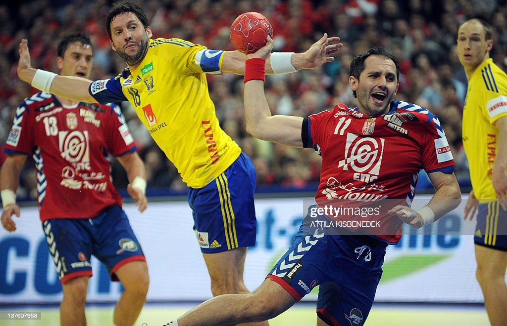 Serbia's Alem Toskic (2nd R) scores past Sweden's Tobias Karlsson (2nd L) during the men's EHF Euro 2012 Handball Championship match between Serbia and Sweden at the Belgrade Arena on January 23, 2012.