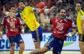 Serbia's Alem Toskic scores past Sweden's Tobias Karlsson during the men's EHF Euro 2012 Handball Championship match between Serbia and Sweden at the...