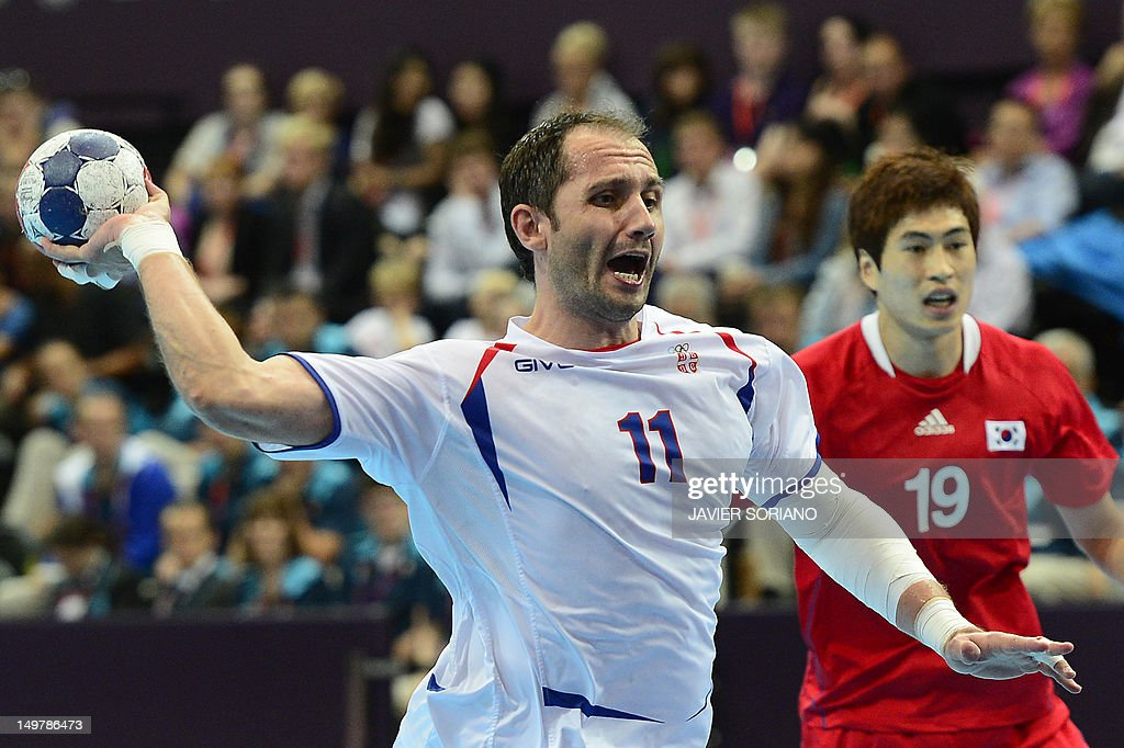 Serbia's Alem Toskic shoots during the men's preliminary Group B handball match South Korea vs Serbia for the London 2012 Olympics Games on August 4, 2012 at the Copper Box hall in London.