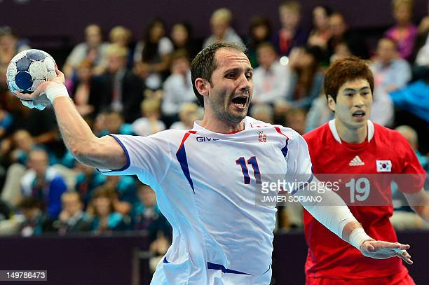 Serbia's Alem Toskic shoots during the men's preliminary Group B handball match South Korea vs Serbia for the London 2012 Olympics Games on August 4...