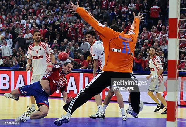 Serbia's Alem Toskic tries to score in front of Croatia's goalkeeper Mirko Alilovic during the men's EHF Euro 2012 Handball Championship semifinal...