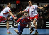 Serbia's Alem Toskic tries to score in front of Poland's Michal Jurecki and Marcin Lijewski during their World Handball Championship match in Zadar...
