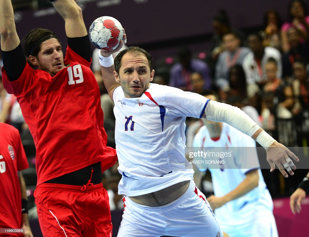 Serbia's Alem Toskic (R) tries to shoot in front of Hungary's rightback Laszlo Zoltan Nagy (L) during their London 2012 Olympic Games men's preliminary Group B handball match at the Copper Box hall in London on August 6, 2012.