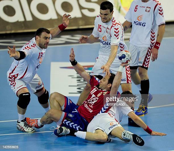 Serbia's Alem Toskic vies with Poland's Michal Jurecki Bartosz Jurecki and Krzysztof Lijewski during the handball preOlympic qualifying match Serbia...