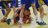 Serbia's Alem Toskic vies with Sweden's players during their men's EHF Euro 2012 Handball Championship match between Serbia and Sweden at the...