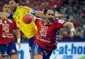 Serbia's Alem Toskic vies with Sweden's Tobias Karlsson during the men's EHF Euro 2012 Handball Championship match between Serbia and Sweden at the...