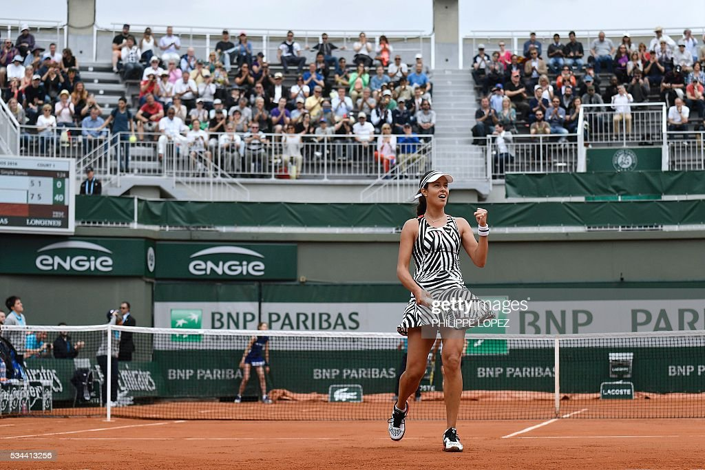 Serbia's Ana Ivanovic celebrates after winning her women's second round match against Japan's Kurumi Nara at the Roland Garros 2016 French Tennis Open in Paris on May 26, 2016. / AFP / PHILIPPE