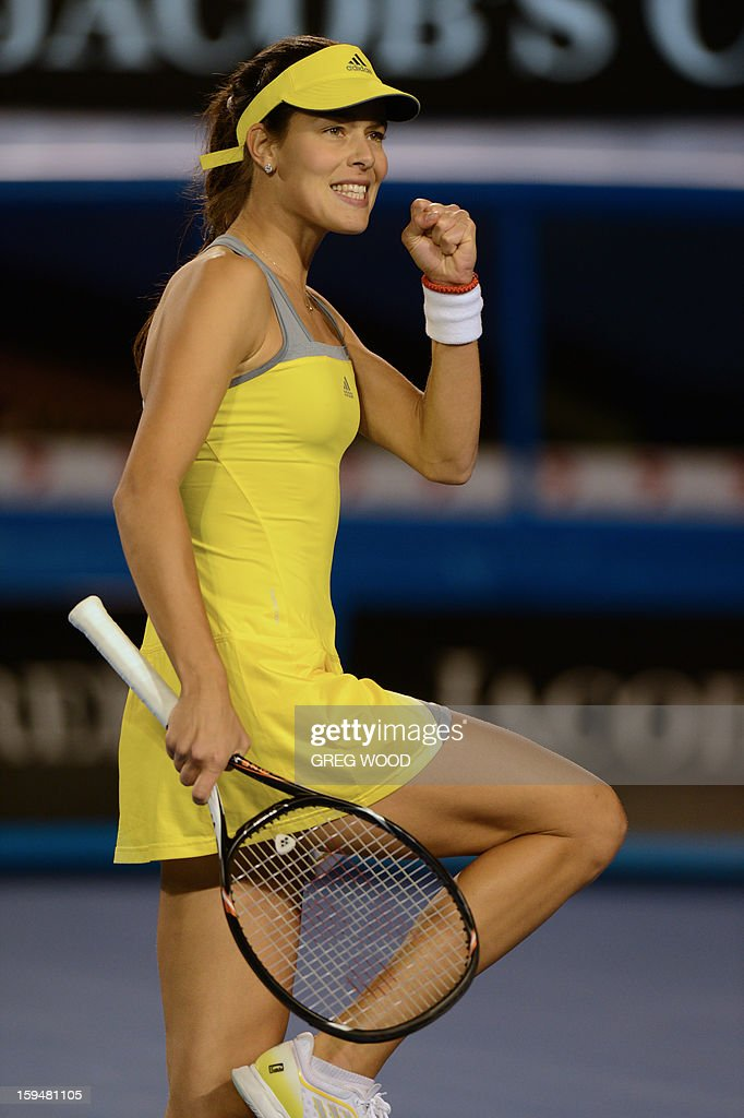 Serbia's Ana Ivanovic gestures as she celebrates after victory in her women's singles match against Hungary's Melinda Czink on the first day of the Australian Open tennis tournament in Melbourne on January 14, 2013.