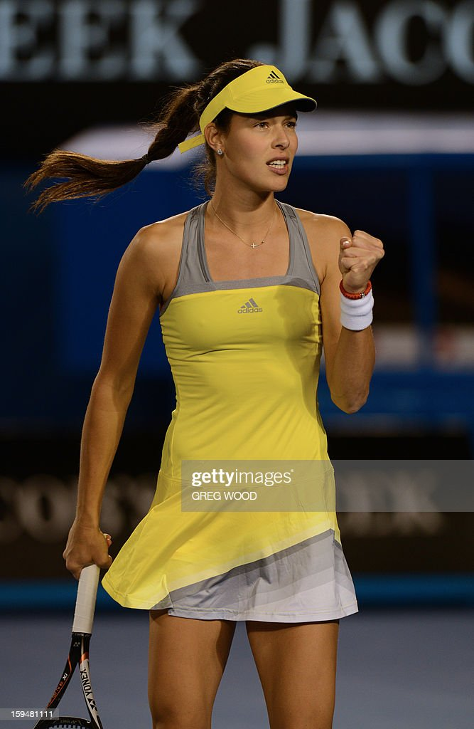 Serbia's Ana Ivanovic gestures as she celebrates after victory in her women's singles match against Hungary's Melinda Czink on the first day of the Australian Open tennis tournament in Melbourne on January 14, 2013. AFP PHOTO/GREG WOOD IMAGE STRICTLY RESTRICTED TO EDITORIAL USE - STRICTLY NO COMMERCIAL USE