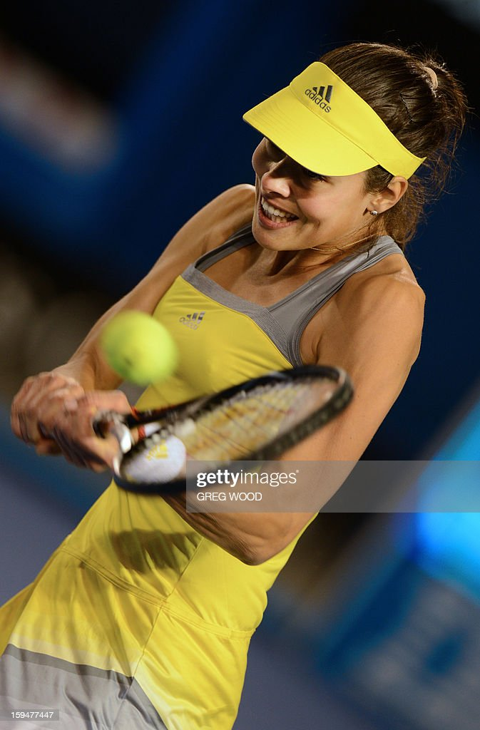 Serbia's Ana Ivanovic plays a return during her women's singles match against Hungary's Melinda Czink on the first day of the Australian Open tennis tournament in Melbourne on January 14, 2013.