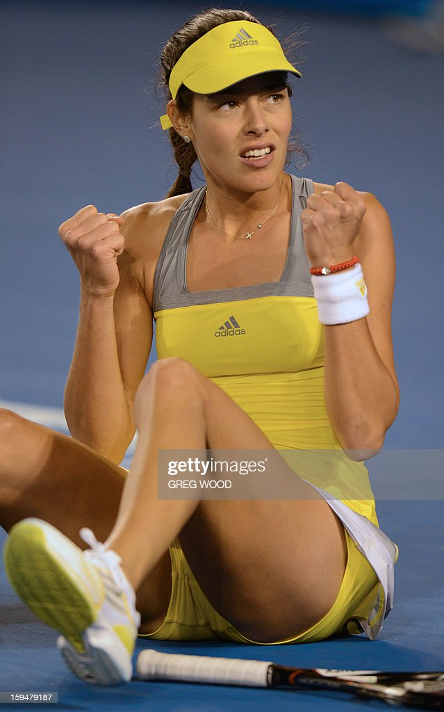 Serbia's Ana Ivanovic reacts after falling during her women's singles match against Hungary's Melinda Czink on the first day of the Australian Open tennis tournament in Melbourne on January 14, 2013.