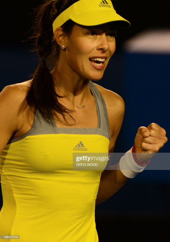 Serbia's Ana Ivanovic reacts during her women's singles match against Hungary's Melinda Czink on the first day of the Australian Open tennis tournament in Melbourne on January 14, 2013. AFP PHOTO/GREG WOOD IMAGE STRICTLY RESTRICTED TO EDITORIAL USE - STRICTLY NO COMMERCIAL USE