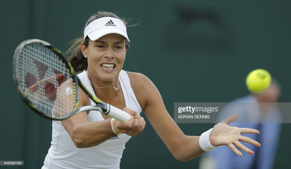 Serbia's Ana Ivanovic returns against Russia's Ekaterina Alexandrova during their women's singles first round match on the first day of the 2016 Wimbledon Championships at The All England Lawn Tennis Club in Wimbledon, southwest London, on June 27, 2016. / AFP / ADRIAN