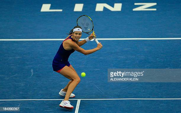 Serbia's Ana Ivanovic returns the ball to Germany's Angelique Kerber during their final match of the WTA tennis tournament in Linz Austria on October...