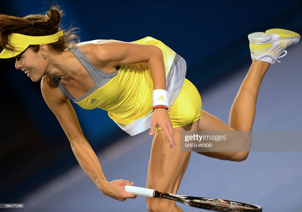 Serbia's Ana Ivanovic serves during her women's singles match against Hungary's Melinda Czink on the first day of the Australian Open tennis tournament in Melbourne on January 14, 2013. AFP PHOTO/GREG WOOD IMAGE STRICTLY RESTRICTED TO EDITORIAL USE - STRICTLY NO COMMERCIAL USE