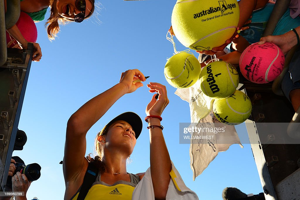 Serbia's Ana Ivanovic signs autographs after victory in her women's singles match against Chan Yung-Jan of Taiwan on the third day of the Australian Open tennis tournament in Melbourne on January 16, 2013. AFP PHOTO/WILLIAM WEST IMAGE STRICTLY RESTRICTED TO EDITORIAL USE - STRICTLY NO COMMERCIAL USE
