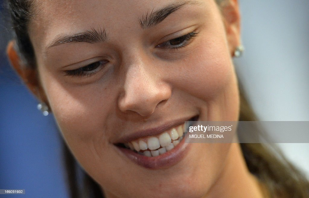 Serbia's Ana Ivanovic smiles as she signs autographs in a sportswear store in Paris on May 22, 2013, two days ahead of the French Tennis Open tournament. AFP PHOTO MIGUEL MEDINA