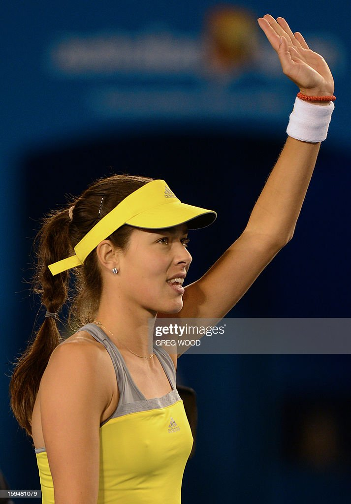Serbia's Ana Ivanovic waves to the crowd as she celebrates after victory in her women's singles match against Hungary's Melinda Czink on the first day of the Australian Open tennis tournament in Melbourne on January 14, 2013.