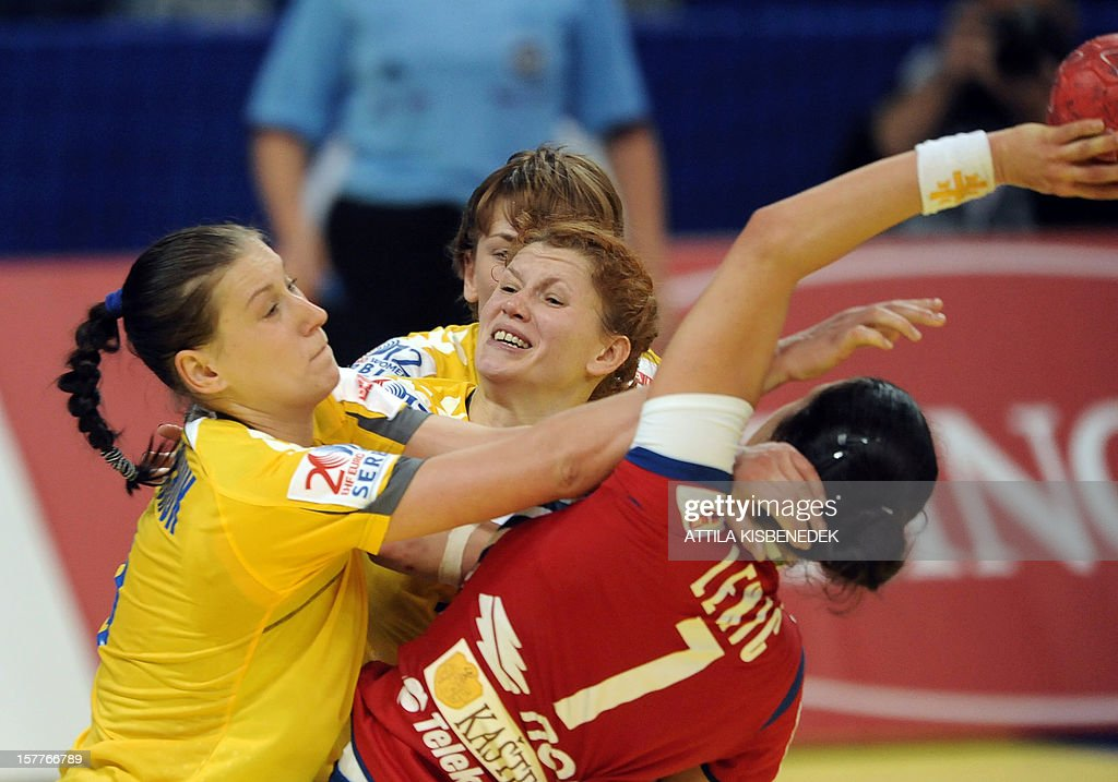 Serbia's Andrea Lekic (R) is fouled by Ukraine's defender during the 2012 EHF European Women's Handball Championship match between Serbia and Ukraine on December 6 , 2012, at the KOMBANK Arena of Belgrade. The Serbian capital Belgrade hosts the preliminary round Group A matches, including those involving the Czech Republic, Norway, Serbia and Ukraine. Serbia won 25-23.