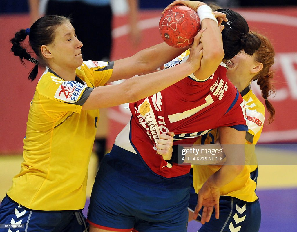 Serbia's Andrea Lekic (R) is fouled by Ukraine's defender during the 2012 EHF European Women's Handball Championship match between Serbia and Ukraine on December 6 , 2012, at the KOMBANK Arena of Belgrade. The Serbian capital Belgrade hosts the preliminary round Group A matches, including those involving the Czech Republic, Norway, Serbia and Ukraine. Serbia won 25-23. AFP PHOTO / ATTILA KISBENEDEK