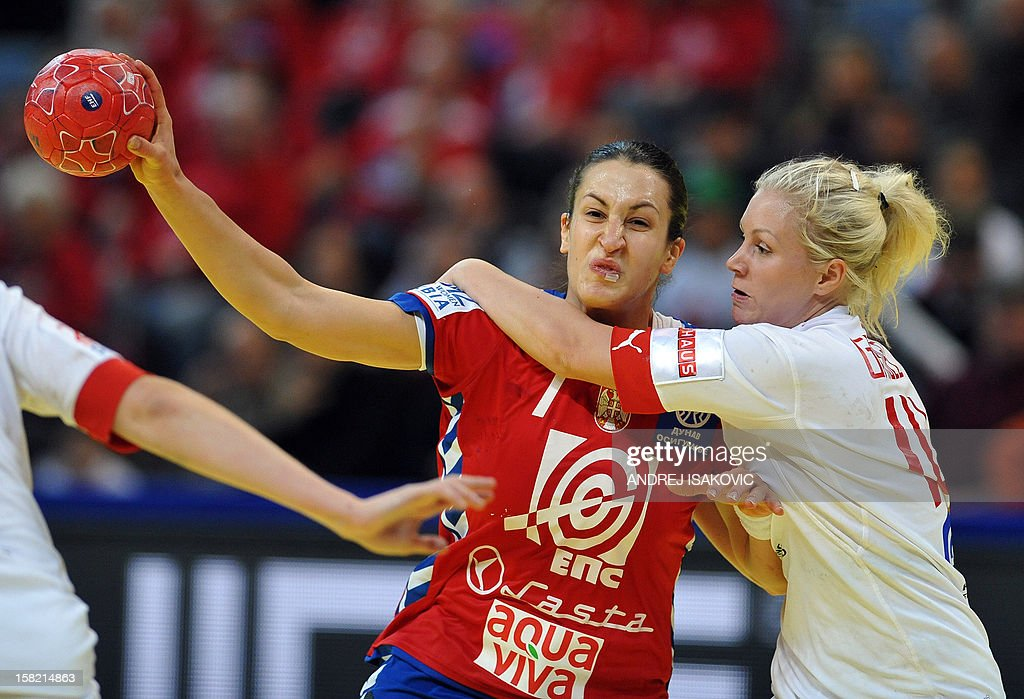 Serbia's Andrea Lekic (L) vies with Denmark's Lotte Grigel during their Women's EHF Euro 2012 Handball Championship match Serbia vs Denmark on December 11, 2012, at the Belgrade Arena.
