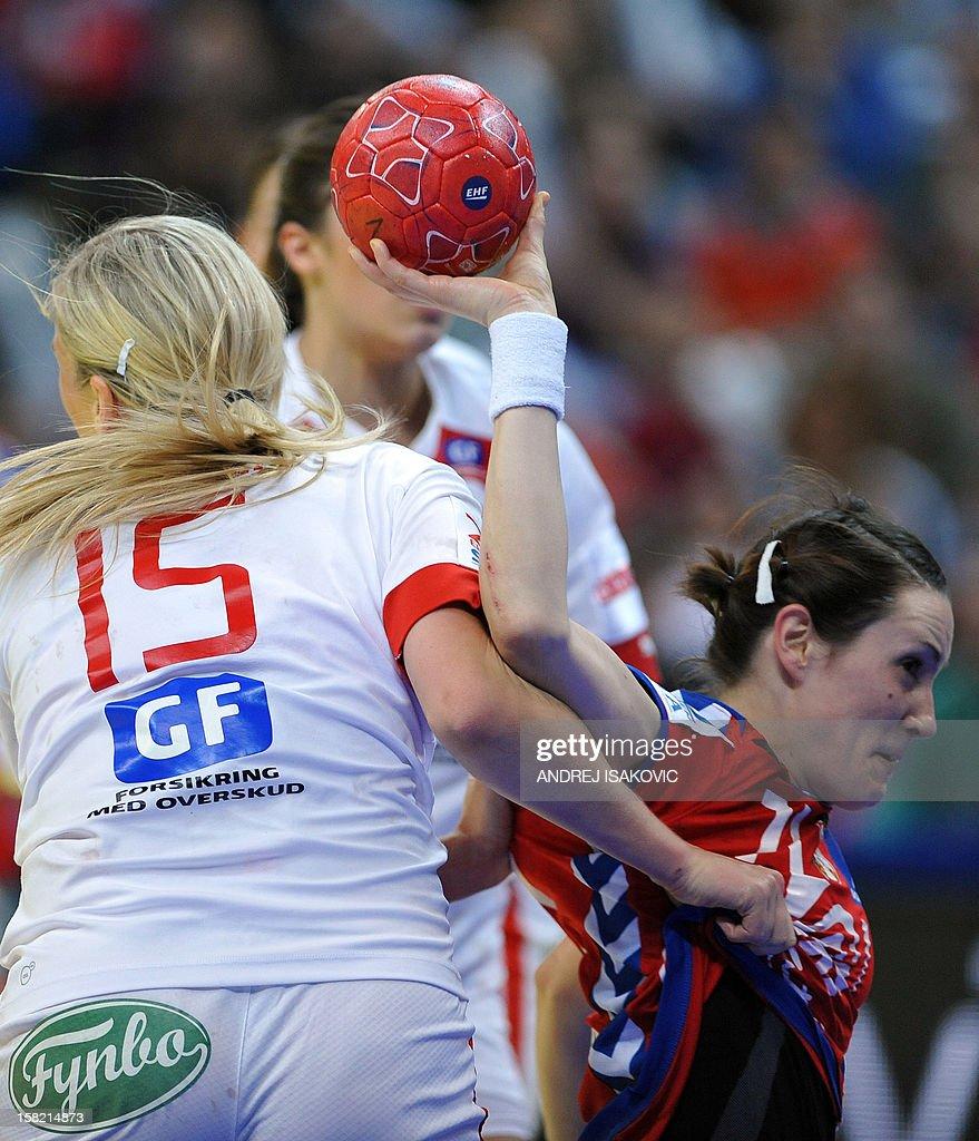 Serbia's Andrea Lekic (R) vies with Denmark's Pernille Holst Larsen (L) during their Women's EHF Euro 2012 Handball Championship match Serbia vs Denmark on December 11, 2012, at the Belgrade Arena.