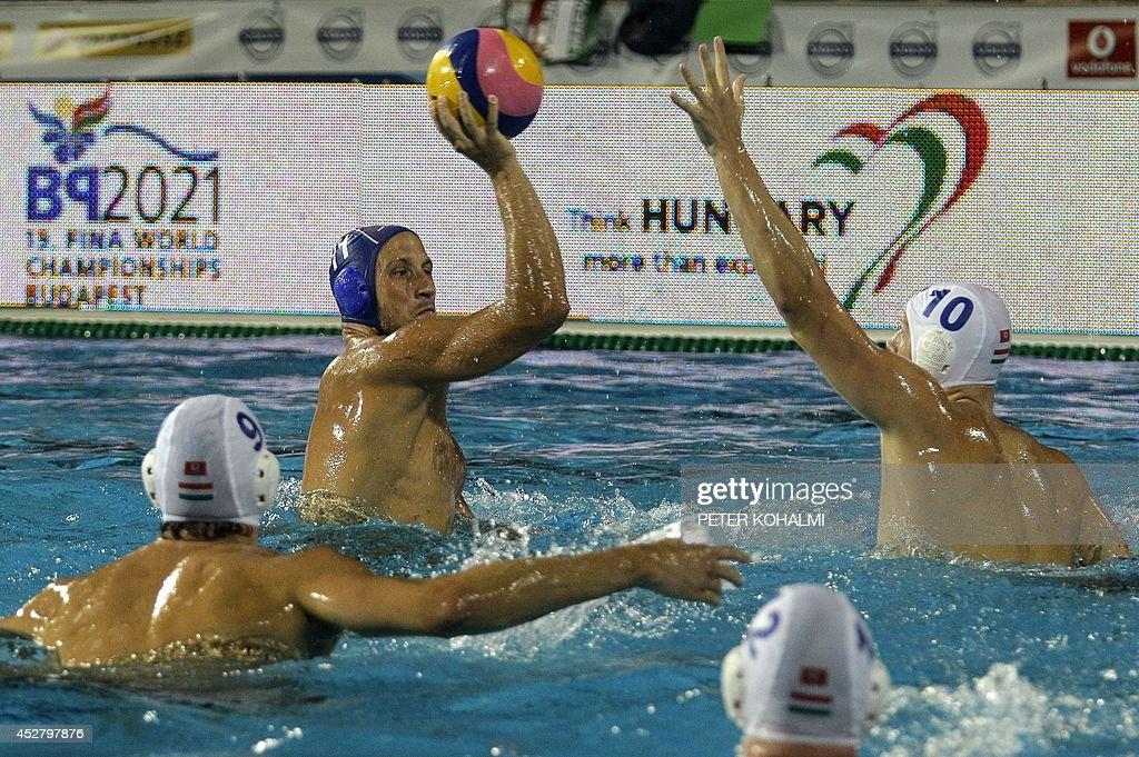 Serbia's Andrija Prlainovic vies with Hungary's Daniel Varga and Denes Varga during the Water Polo European Championships for men's final Hungary vs...