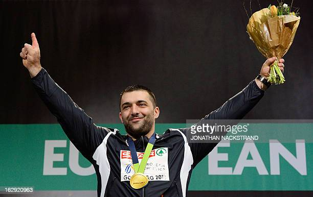 Serbia's Asmir Kolasinac celebrates on the podium after wining the final of the men's Shot Put event at the European Indoor athletics Championships...
