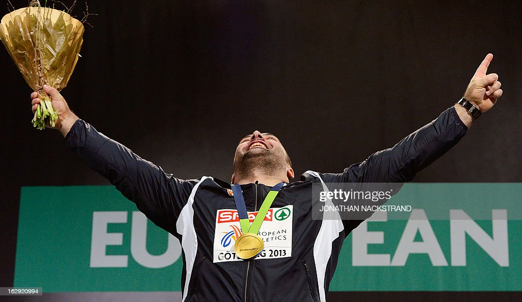 Serbia's Asmir Kolasinac celebrates on the podium after wining the final of the men's Shot Put event at the European Indoor athletics Championships in Gothenburg, Sweden, on March 1, 2013.