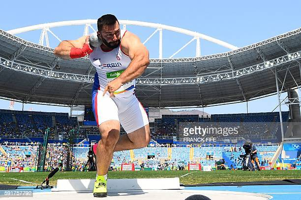 Serbia's Asmir Kolasinac competes in the Men's Shot Put Qualifying Round during the athletics event at the Rio 2016 Olympic Games at the Olympic...