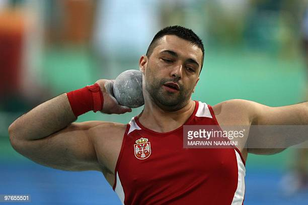 Serbia's Asmir Kolasinac he competes in the men's shot put group B qualifying round at the 2010 IAAF World Indoor Athletics Championships at the...