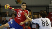 Serbia's back Nenad Vuckovic vies for the balla with Korea's back YunSuk Oh during the 23rd Men's Handball World Championships preliminary round...