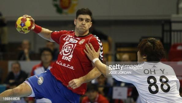 Serbia's back Nenad Vuckovic vies for the balla with Korea's back YunSuk Oh during the 23rd Men's Handball World Championships preliminary round...