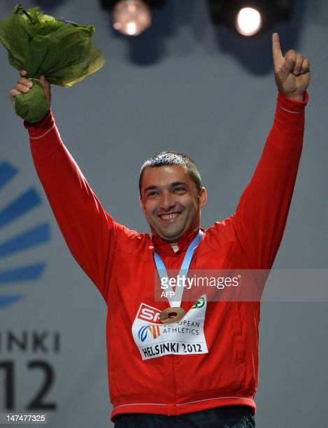 Serbia's bronze medal winner Asmir Kolasinac celebrates on the podium during the medal ceremony for the men's shot put at the 2012 European Athletics...