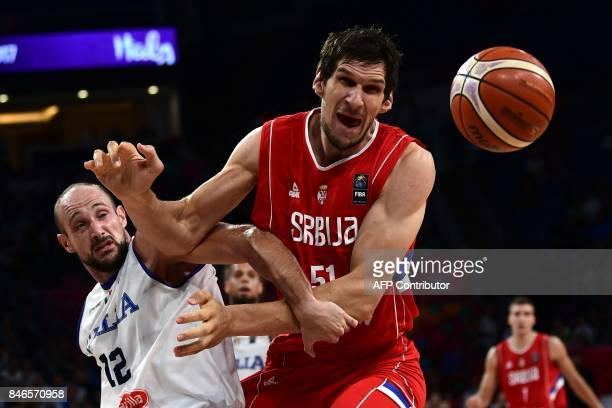 TOPSHOT Serbia`s centre Boban Marjanovic fights for the ball with Italy`s centre Marco Cusin during the FIBA Eurobasket 2017 men's quarterfinal...