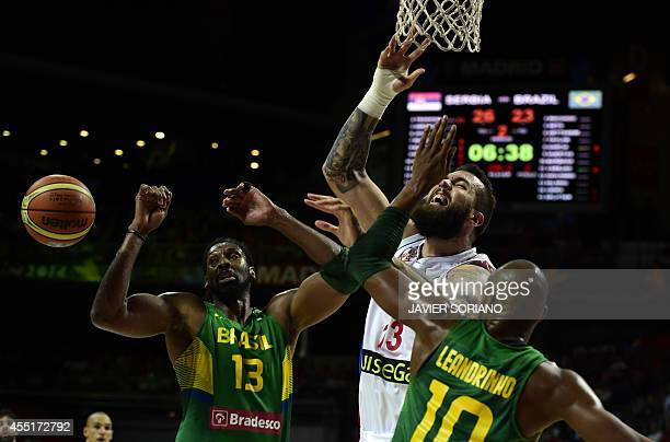 Serbia's centre Miroslav Raduljica vies with Brazil's centre Nene Hilario and Brazil's guard Leandrinho Barbosa during the 2014 FIBA World basketball...