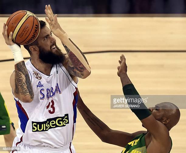 Serbia's centre Miroslav Raduljica vies with Brazil's guard Leandrinho Barbosa during the 2014 FIBA World basketball championships group A match...