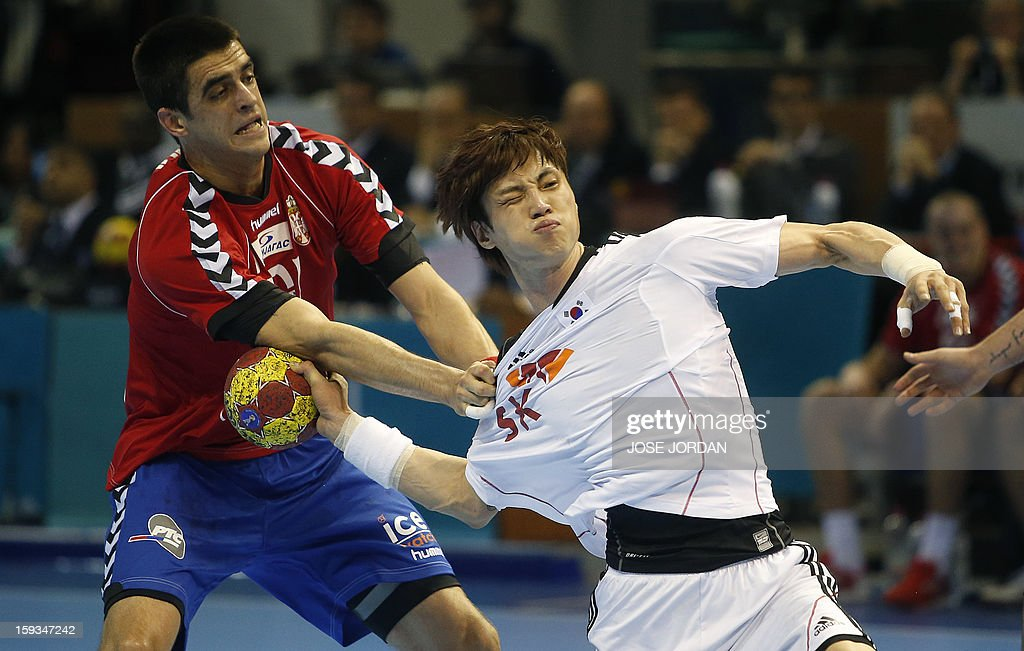 Serbia's centreback Zarko Sesum (L) vies with Korea's back Chan-Yong Park during the 23rd Men's Handball World Championships preliminary round Group C match Serbia vs Korea at the Pabellon Principe Felipe in Zaragoza on January 12, 2013.