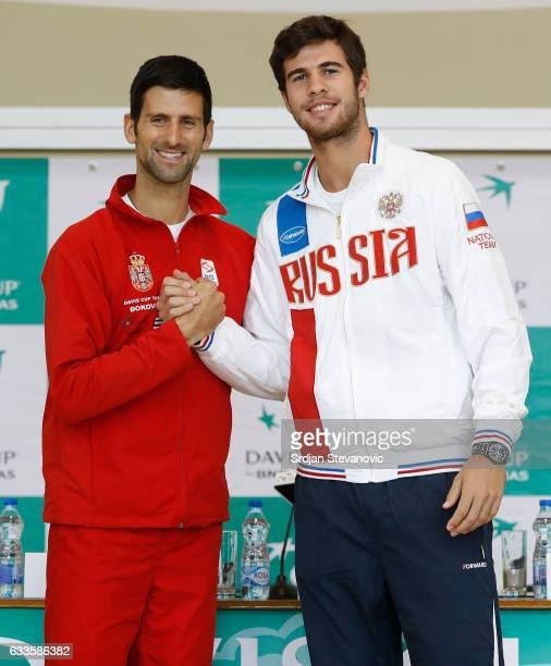 Serbia's Davis Cup team player Novak Djokovic shake hands with the Russia Davis Cup player Karen Khachanov during the official draw ceremony ahead of...