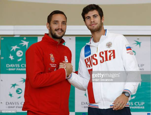 Serbia's Davis Cup team player Viktor Troicki shake hands with the Russia Davis Cup player Karen Khachanov during the official draw ceremony ahead of...