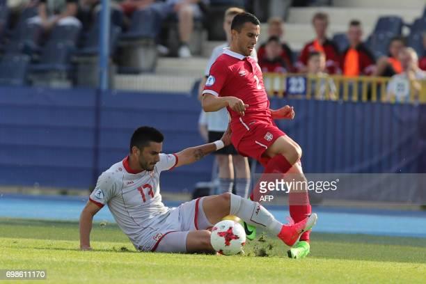 Serbia's defender Milan Gajic and Macedonia's midfielder Kire Markoski vie for the ball during the UEFA U21 European Championship Group B football...