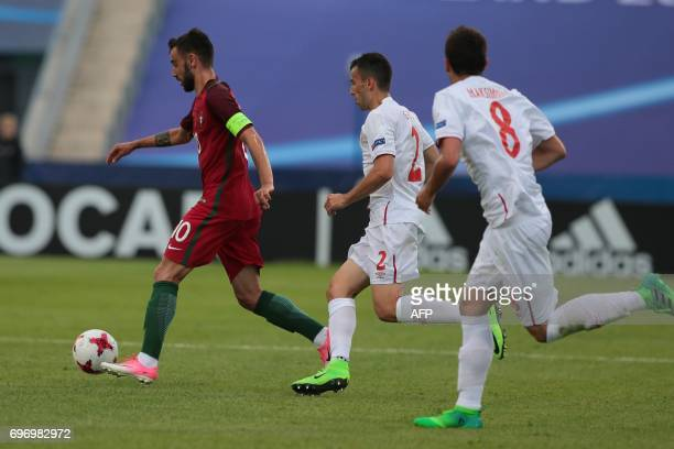 Serbia's defender Milan Gajic and Portugal's midfielder Bruno Portugal's midfielder Bruno Fernandes vie for the ball during the UEFA U21 European...