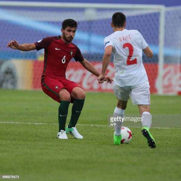 Serbia's defender Milan Gajic and Portugal's midfielder Ruben Neves vie for the ball during the UEFA U21 European Championship Group B football match...