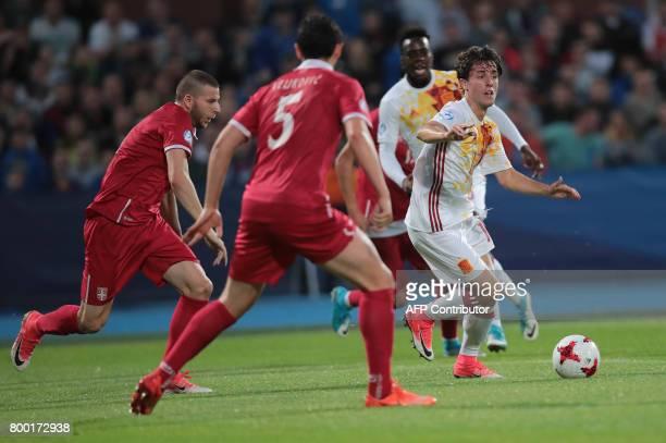 Serbia's defender Nemanja Antonov and Spain's defender Alvaro Odriozola vie for the ball during the UEFA U21 European Championship Group B football...
