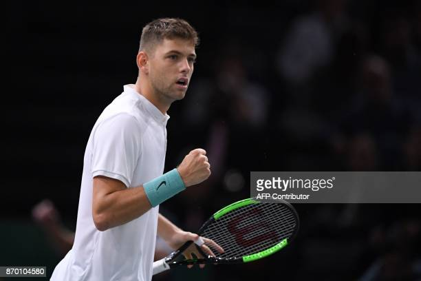 Serbia's Filip Krajinovic celebrates winning a point against USA's John Isner during the semifinal round at the ATP World Tour Masters 1000 indoor...